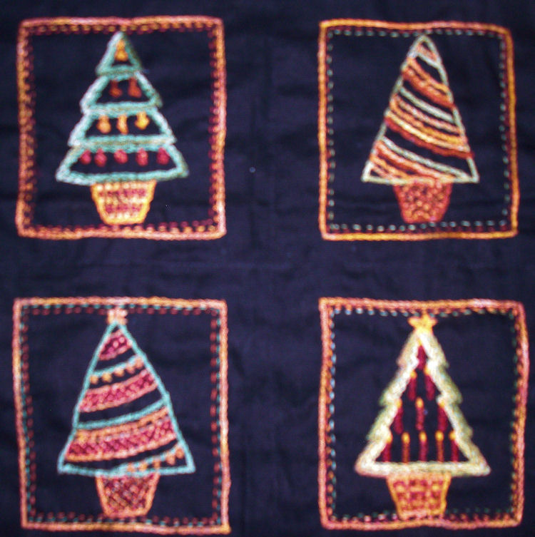 http://aflembroidery.com/new-images/four-christmas-trees.jpg